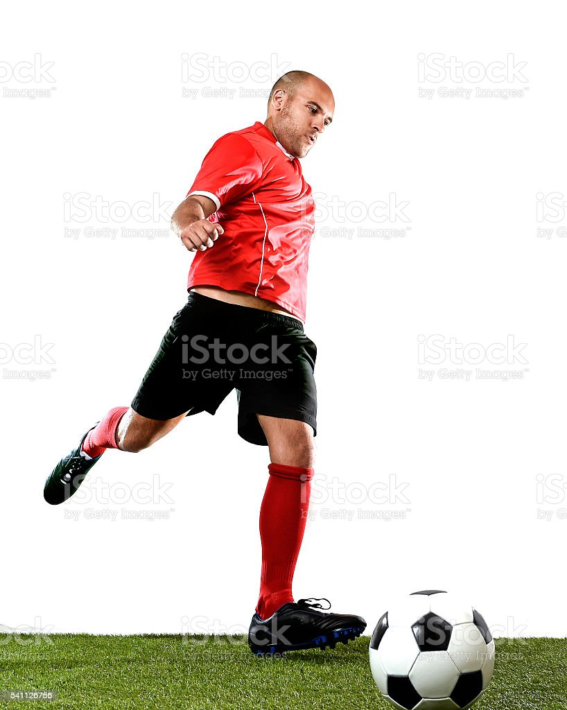 football player kicking ball in free kick shooting action stock photo
