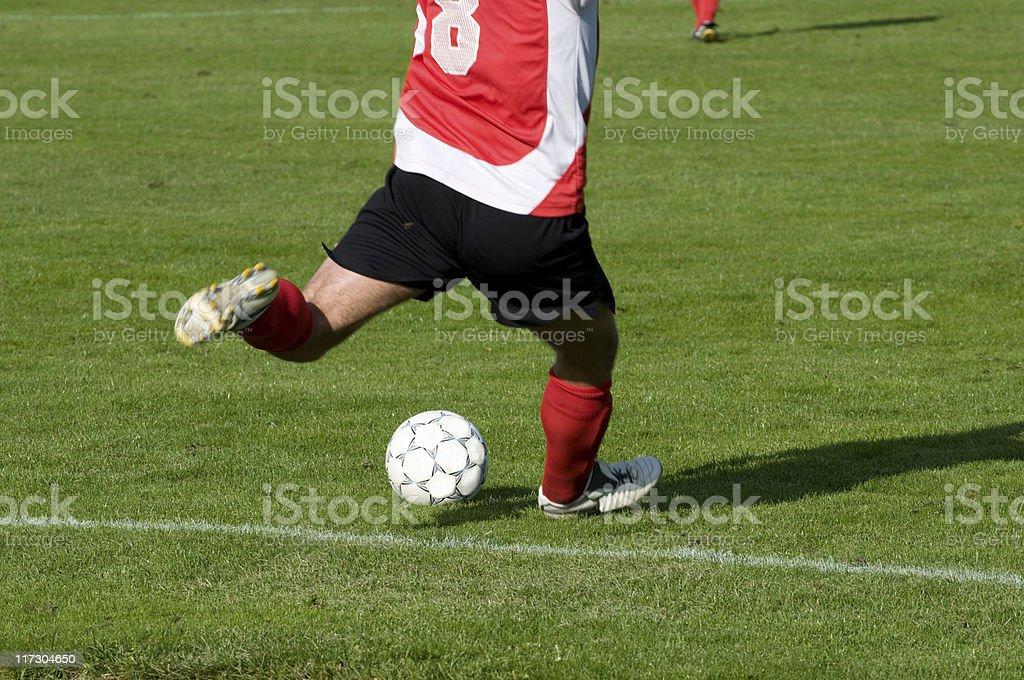 Football player kicks the ball royalty-free stock photo