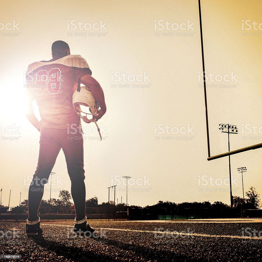 Football player looking at the pitch before the game royalty-free stock photo