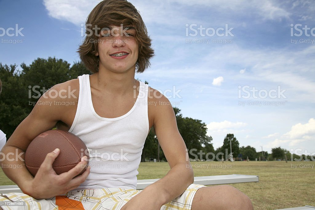 Football Player Outside on a bench, with copy space royalty-free stock photo