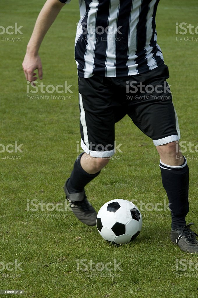 Football player perfoms a difficult dribbling with soccer ball royalty-free stock photo