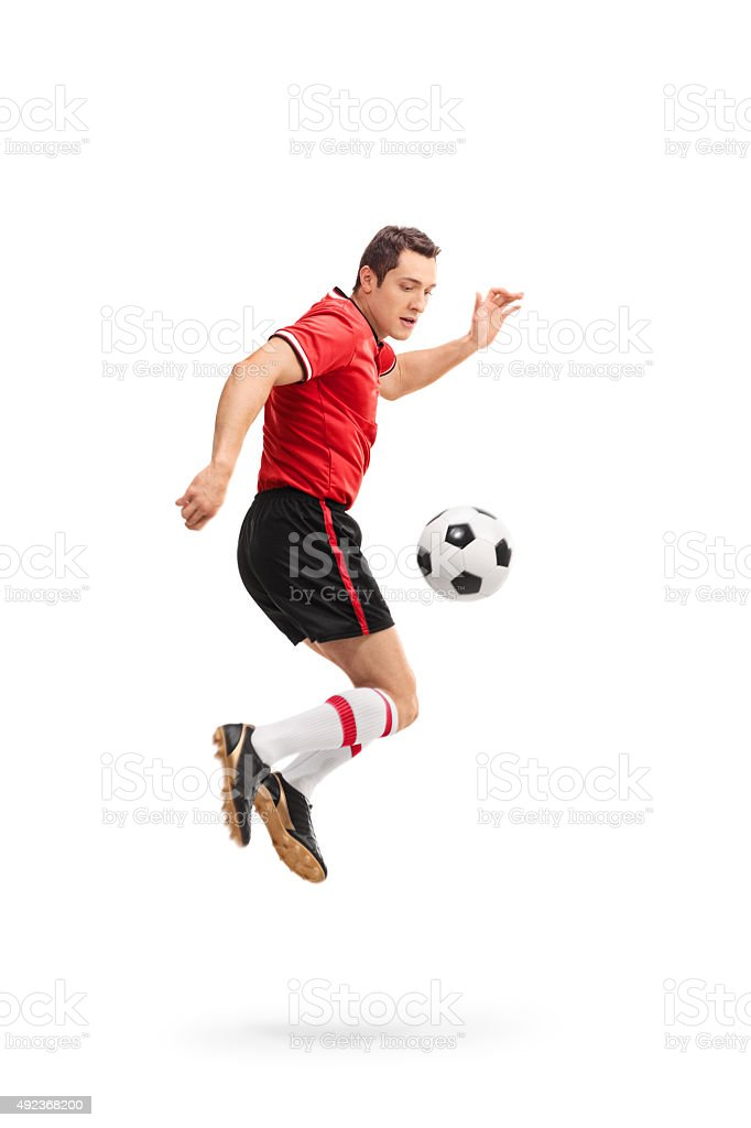 Football player performing a rainbow flick stock photo