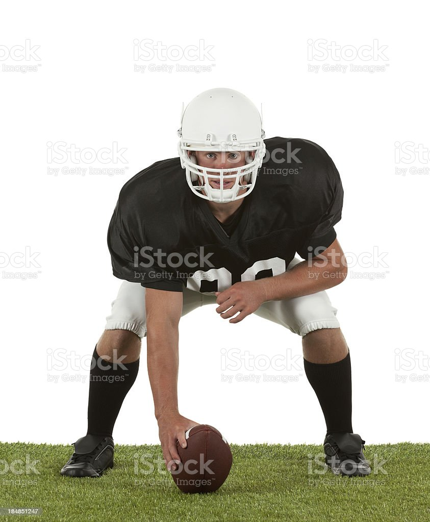 Football player placing a ball in playfield royalty-free stock photo