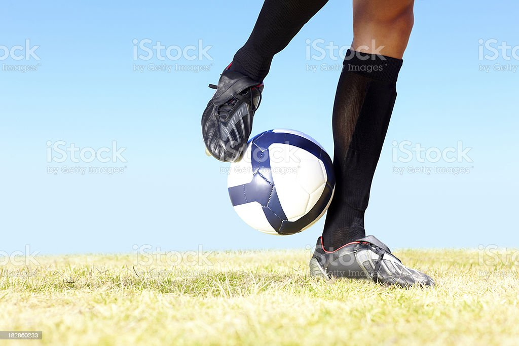 Football player playing with a ball on field royalty-free stock photo