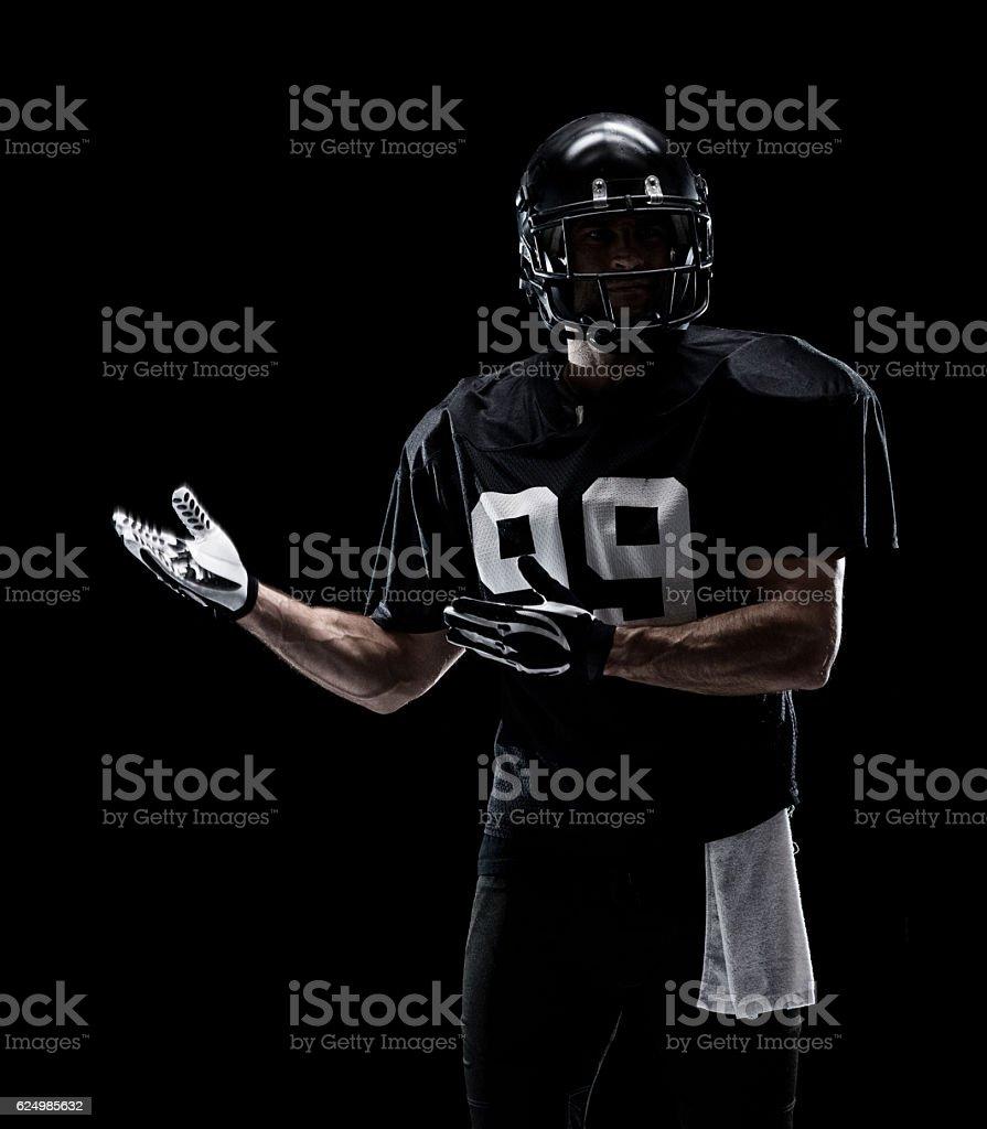 Football player presenting stock photo