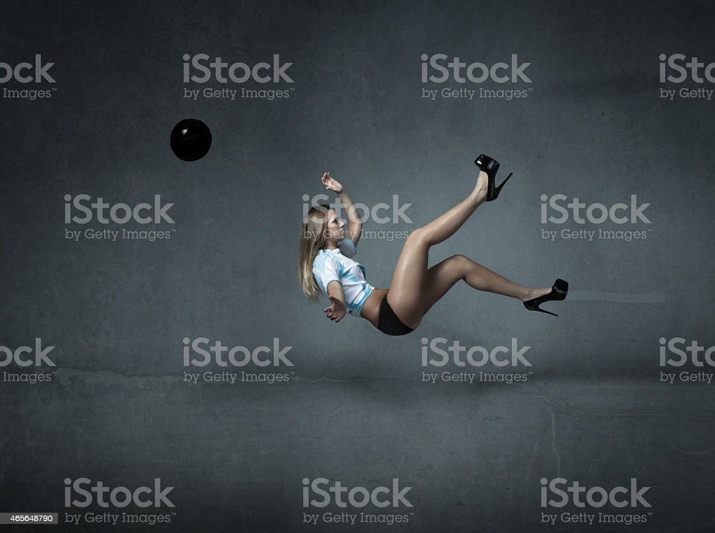 football player ready for a spectacular kick stock photo