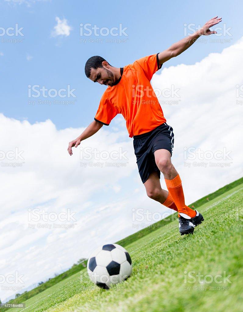 Football player shooting the ball stock photo