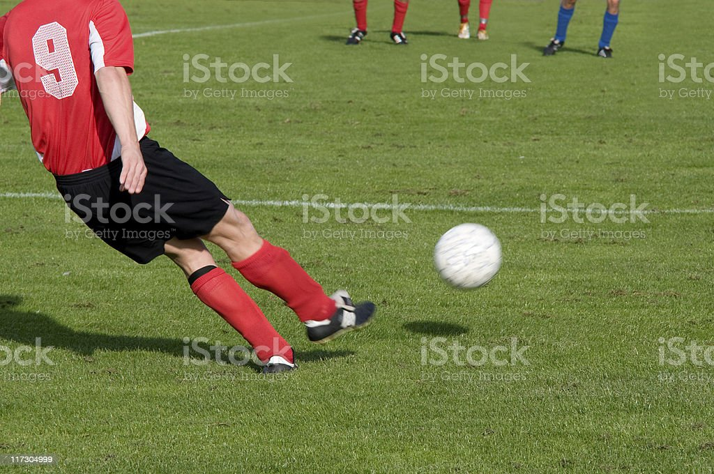 Football player takes a free kick royalty-free stock photo