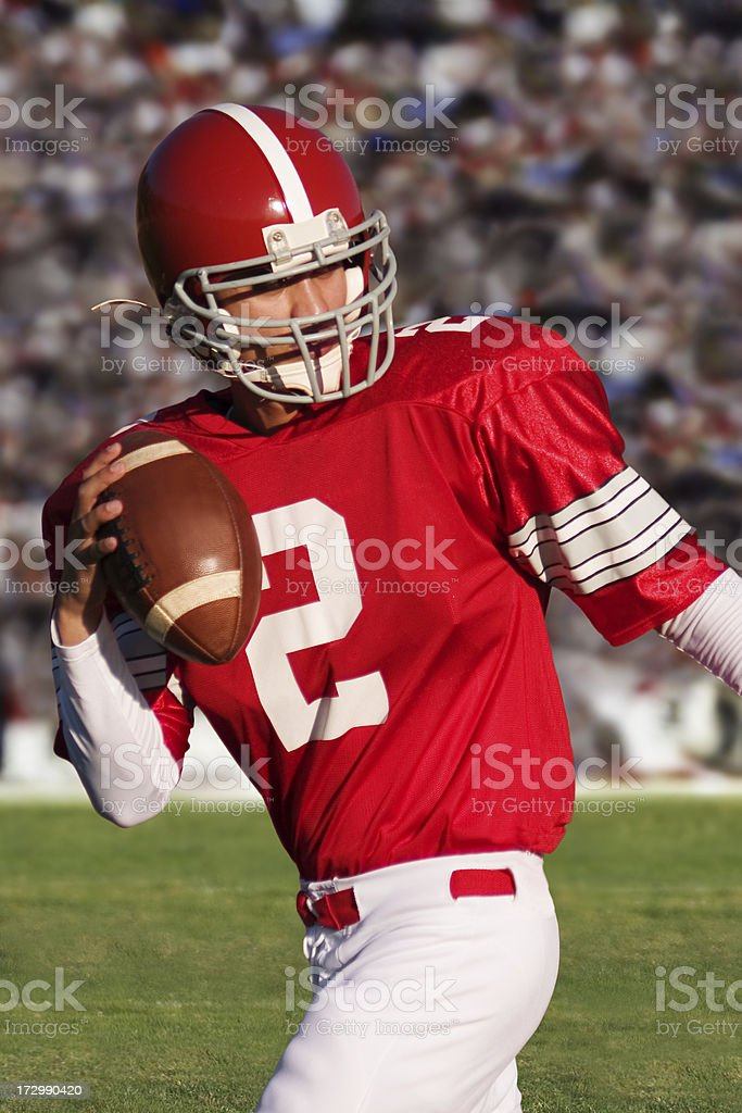 Football Player Throwing A Pass royalty-free stock photo