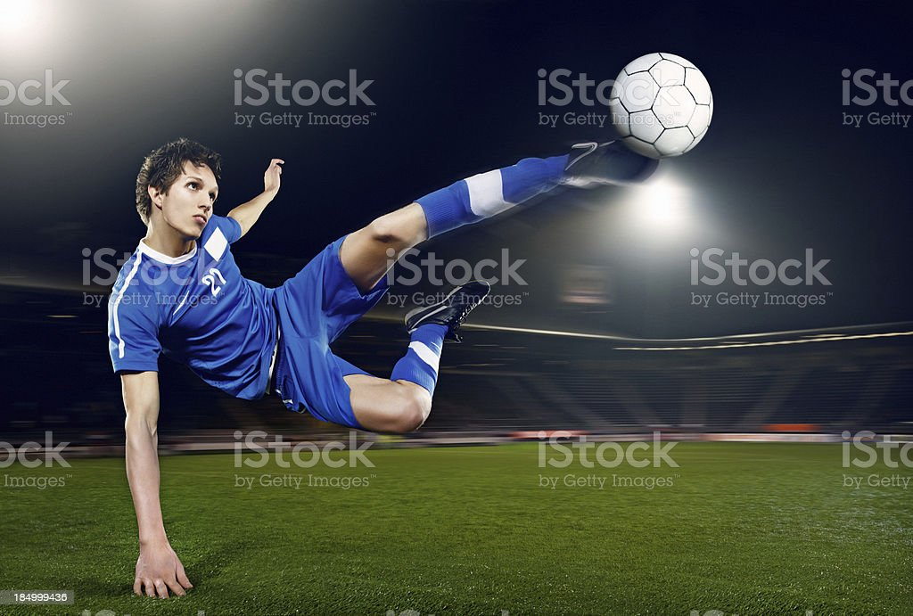 football player volleying ball royalty-free stock photo