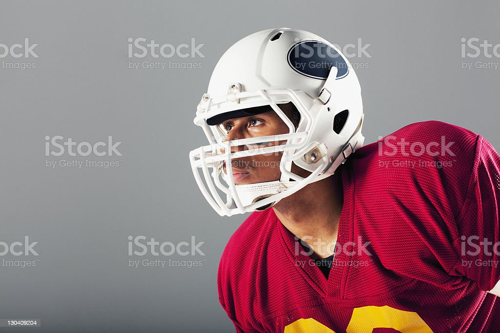 Football player wearing helmet royalty-free stock photo