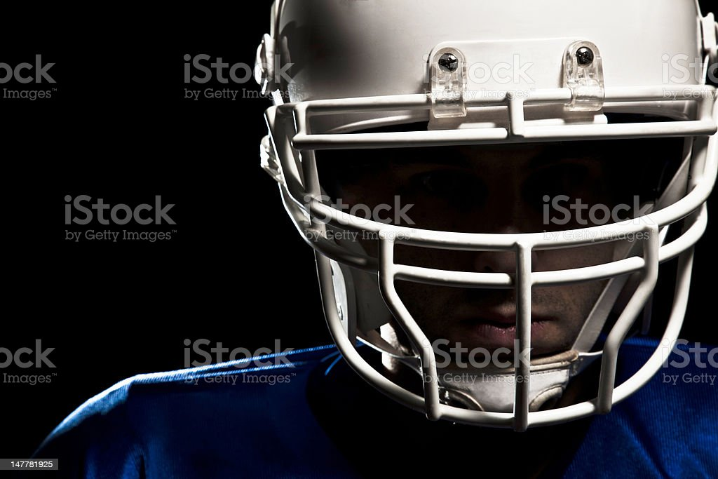 Football player with white helmet and blue jersey royalty-free stock photo
