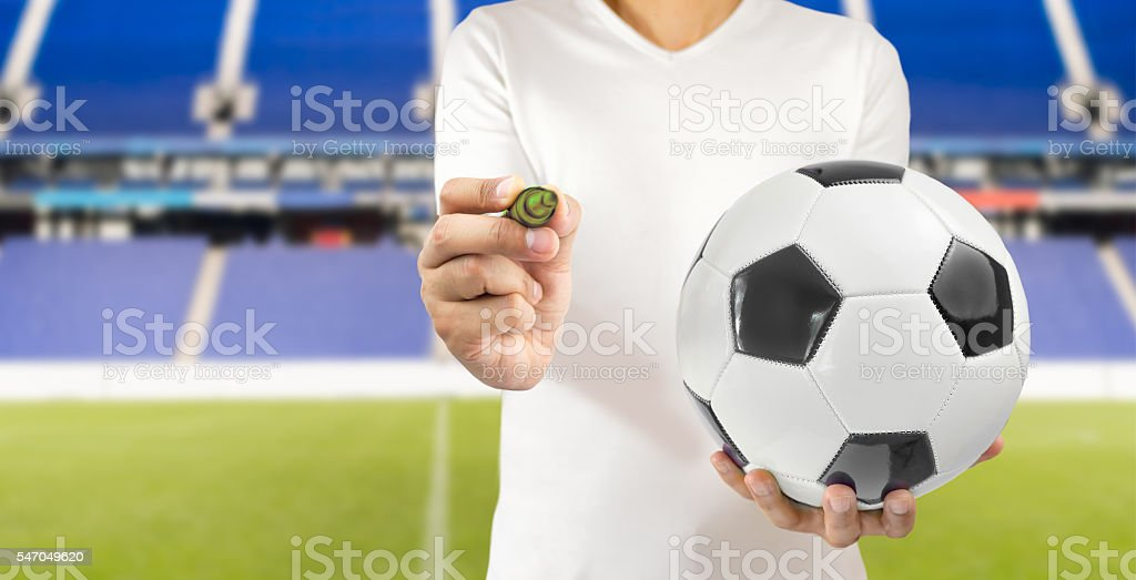 football player writing down stock photo