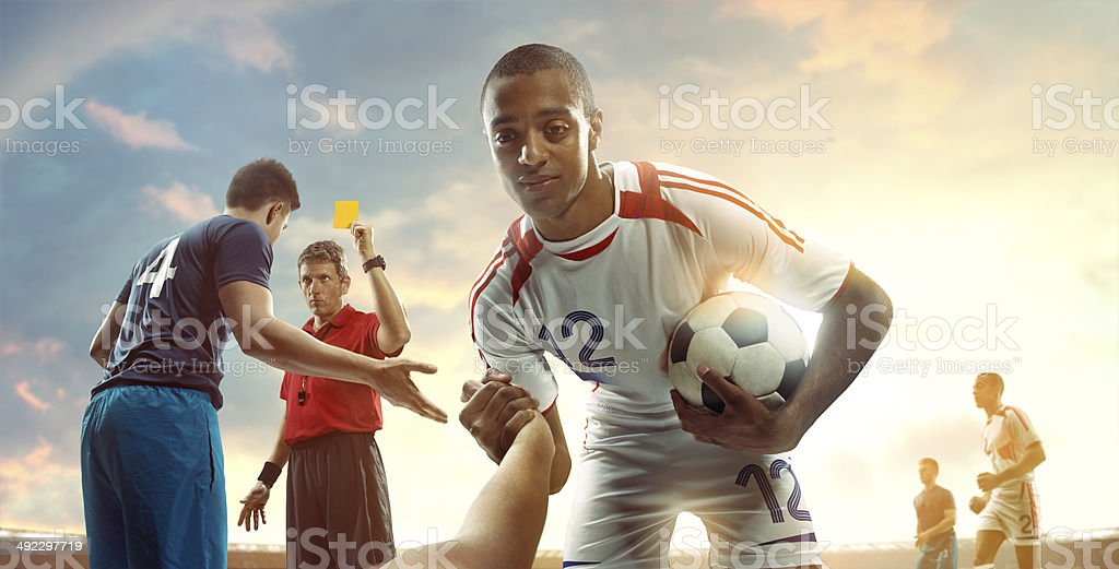 Football players and referee stock photo