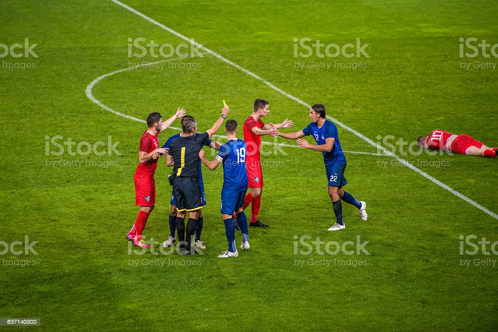 Football players arguing stock photo