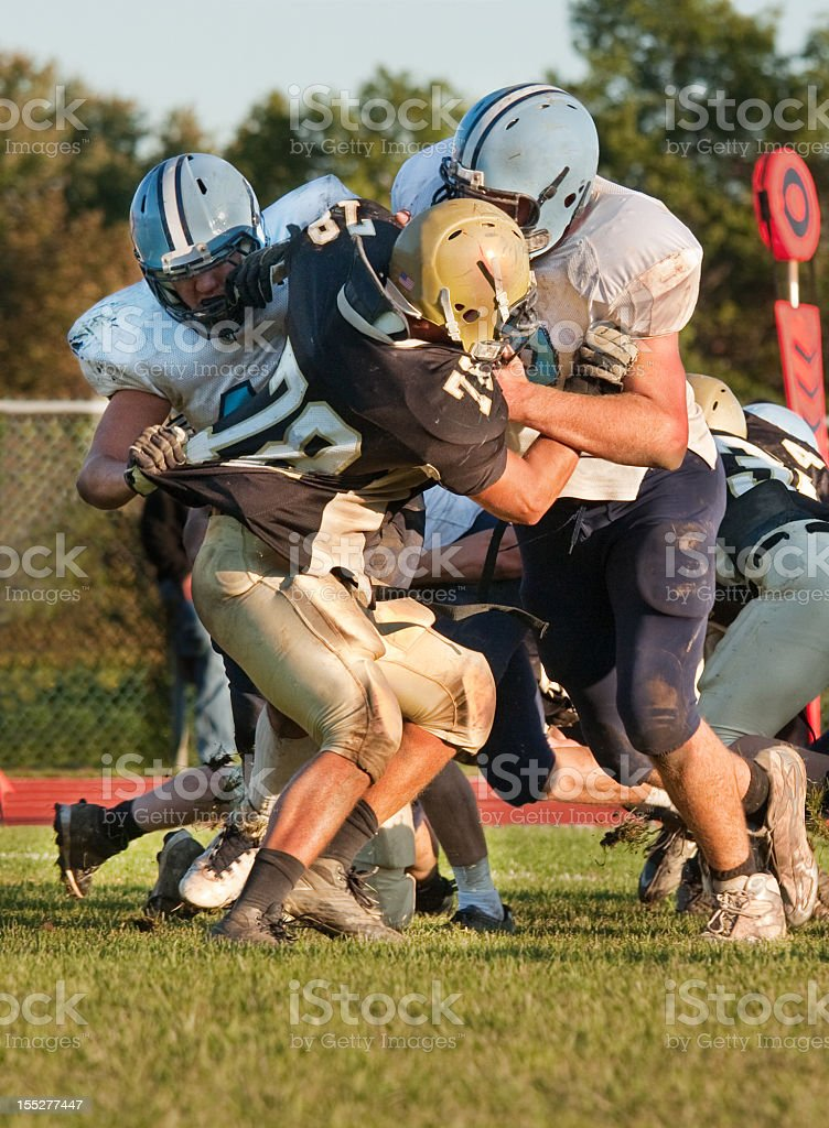 football players blocking an opponent stock photo