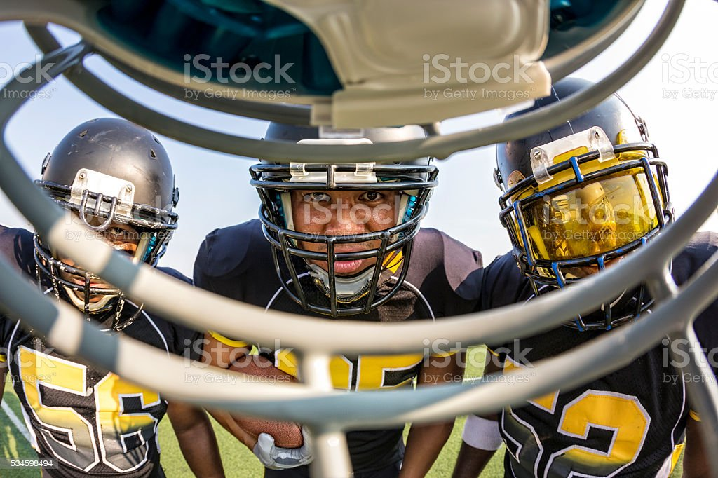 Football Players Get in Each Others Faces stock photo
