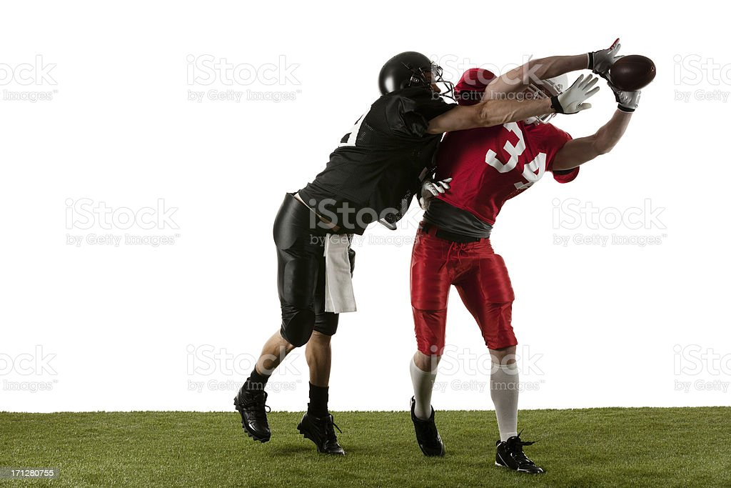 Football players in action stock photo