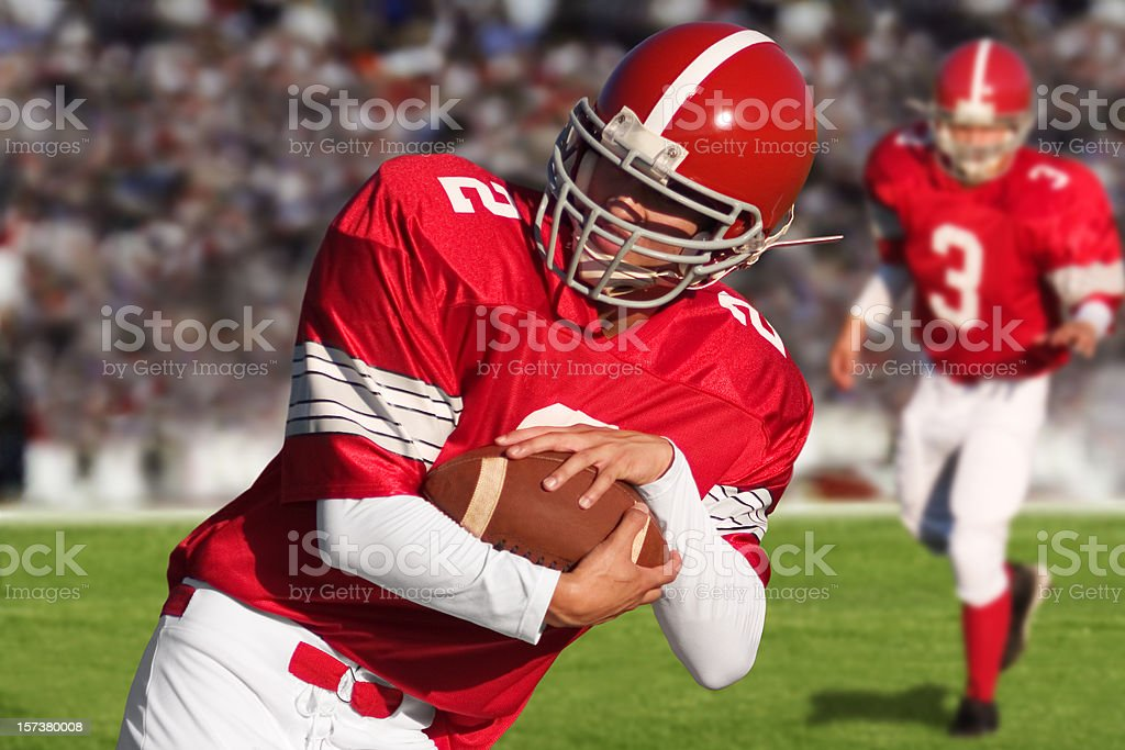Football Players on Field stock photo