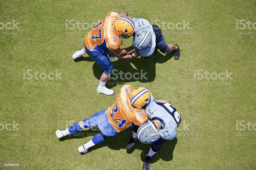 Football players playing football royalty-free stock photo
