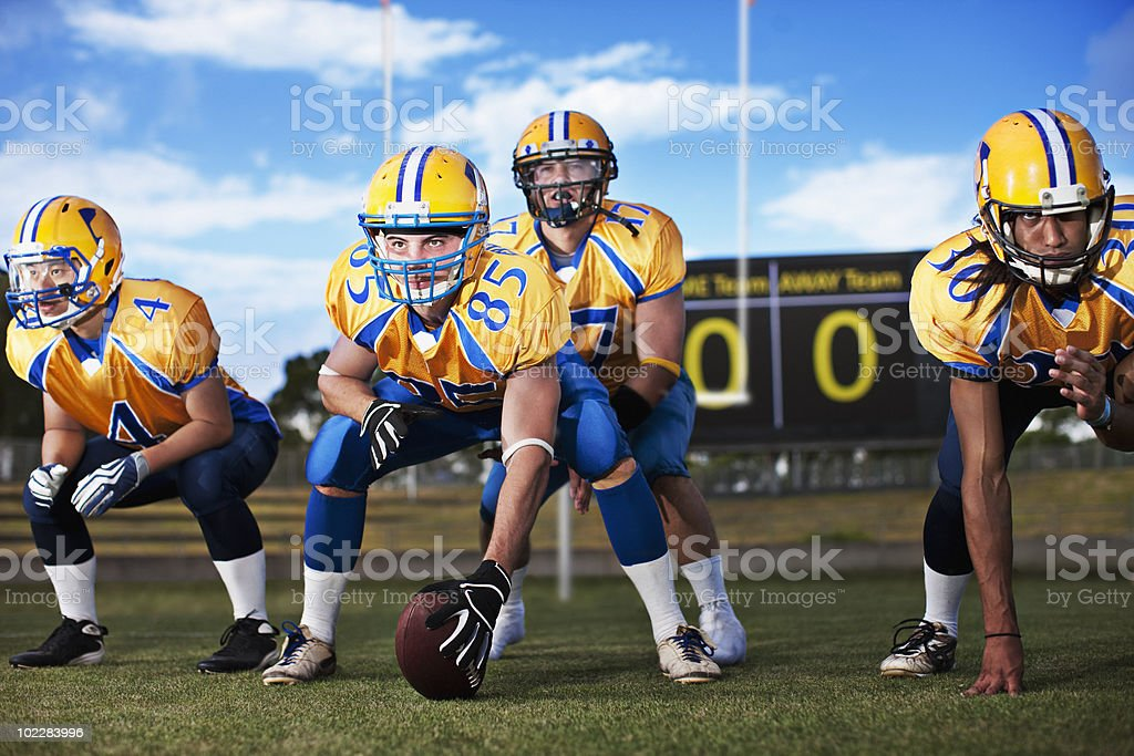 Football players preparing to play football stock photo