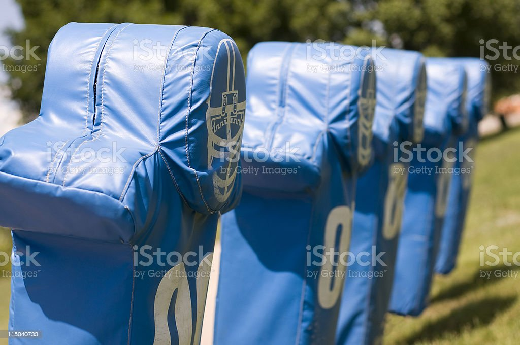 Football Practice Blocking Sled Training Dummies in a Row stock photo