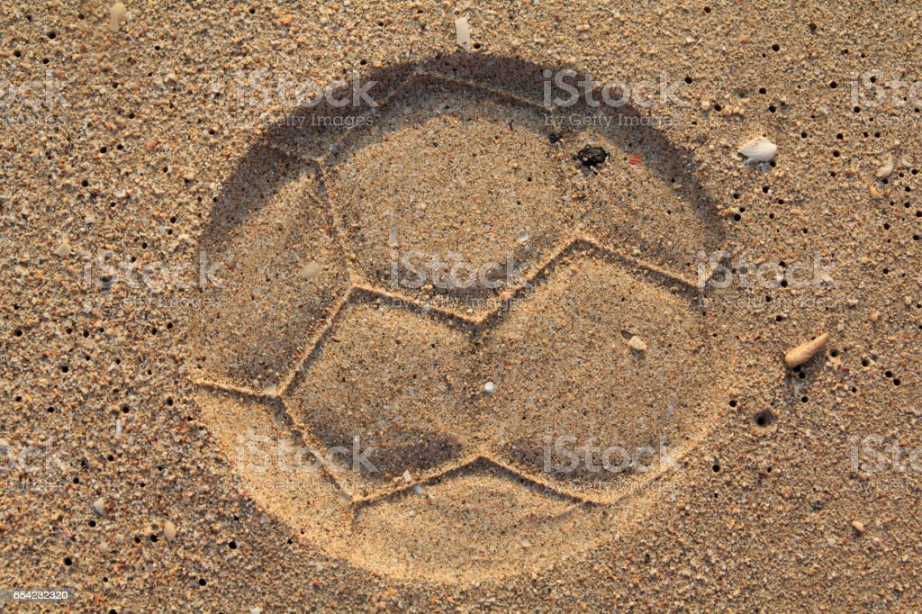 Football Print on a Sand stock photo