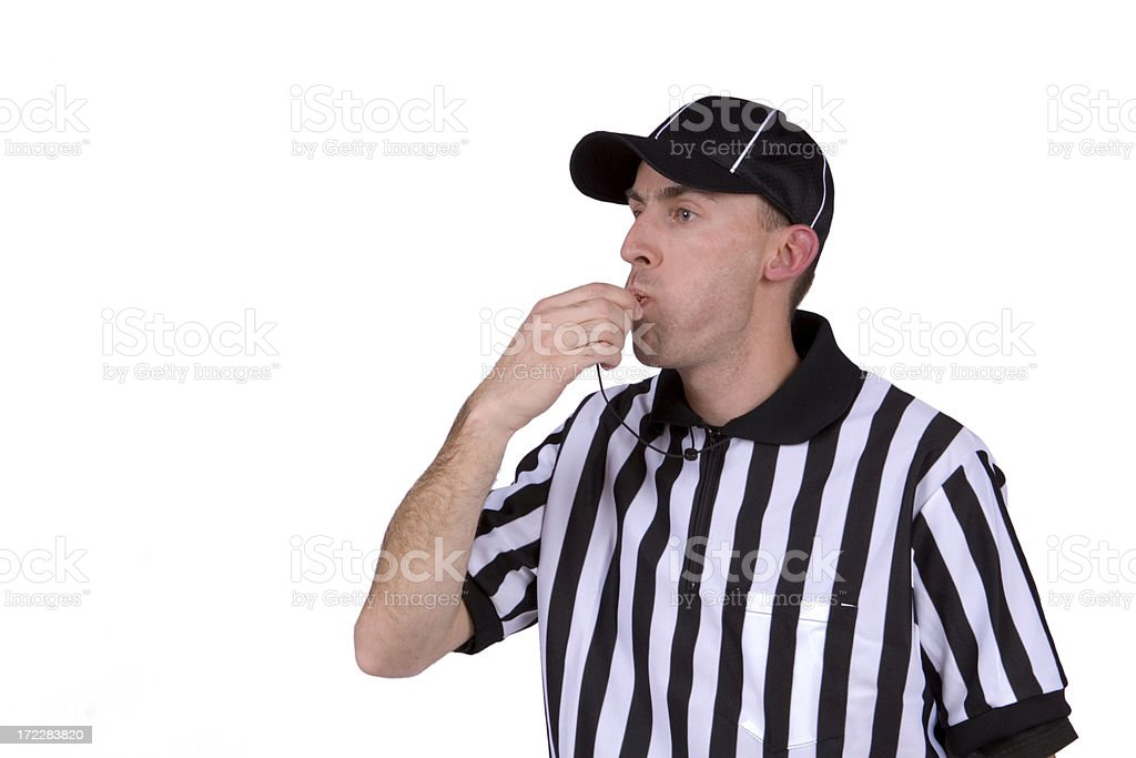 Football referee blowing whistle royalty-free stock photo