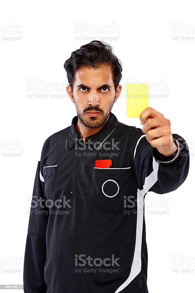 Football referee showing yellow card stock photo