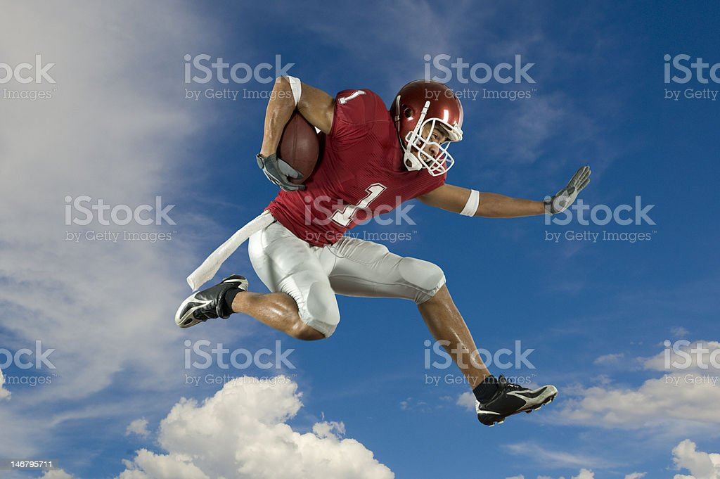 Football Runner with Clouds royalty-free stock photo