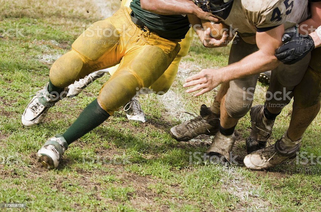 football running back being tackled stock photo