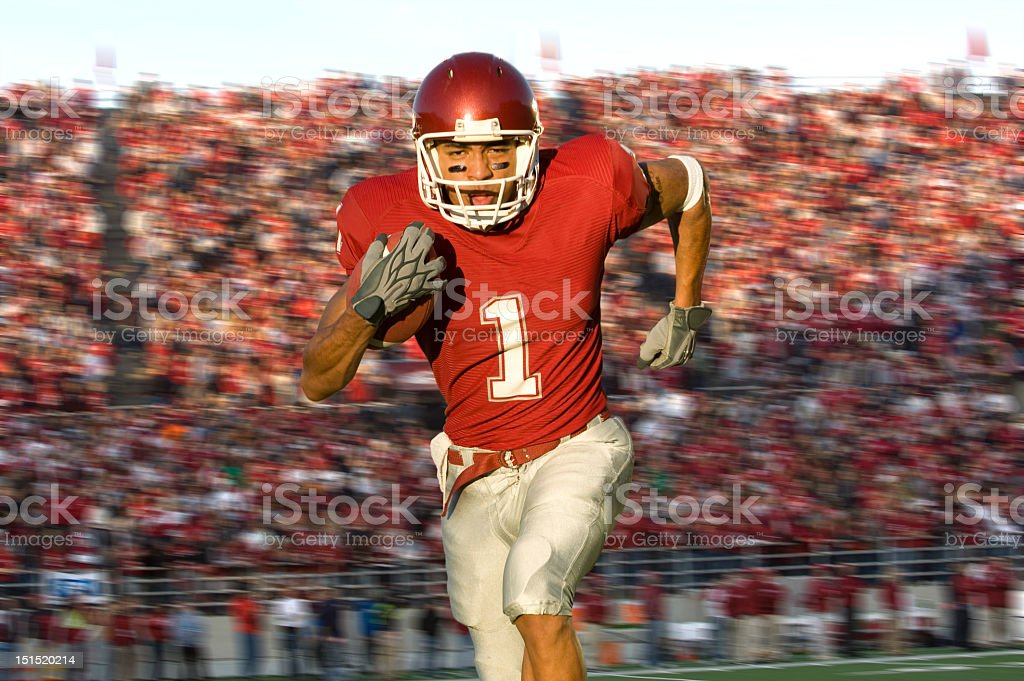 Football Running Back Sprinting Down the Field stock photo