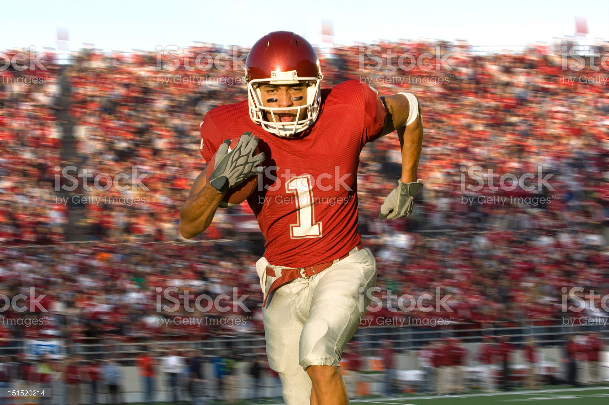 Football Running Back Sprinting Down the Field royalty-free stock photo