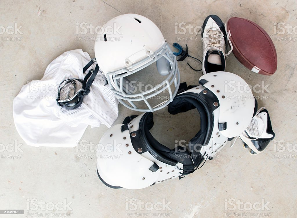 Football Safety Gear and Folded Uniform stock photo