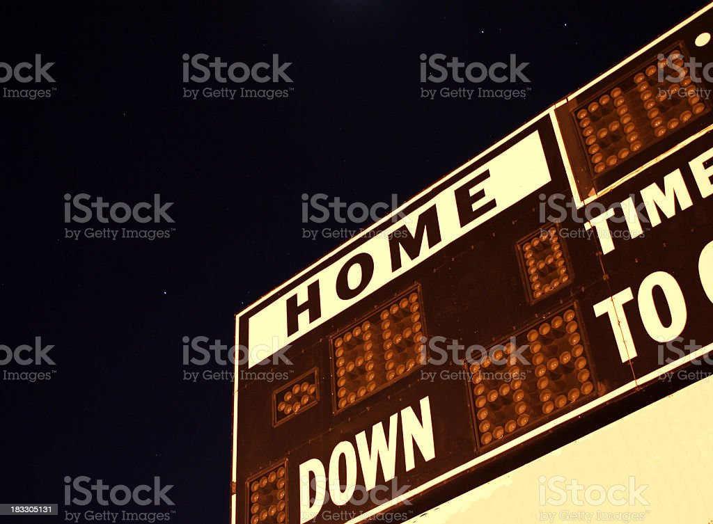 Football scoreboard with no numbers on it in the dark stock photo