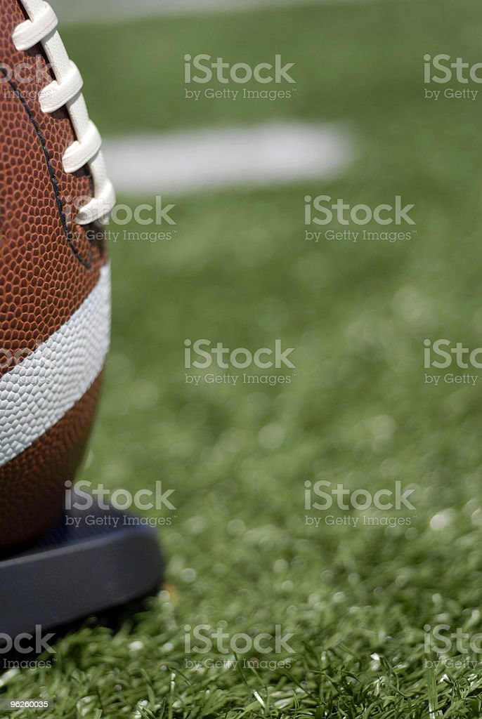Football sitting on tee royalty-free stock photo