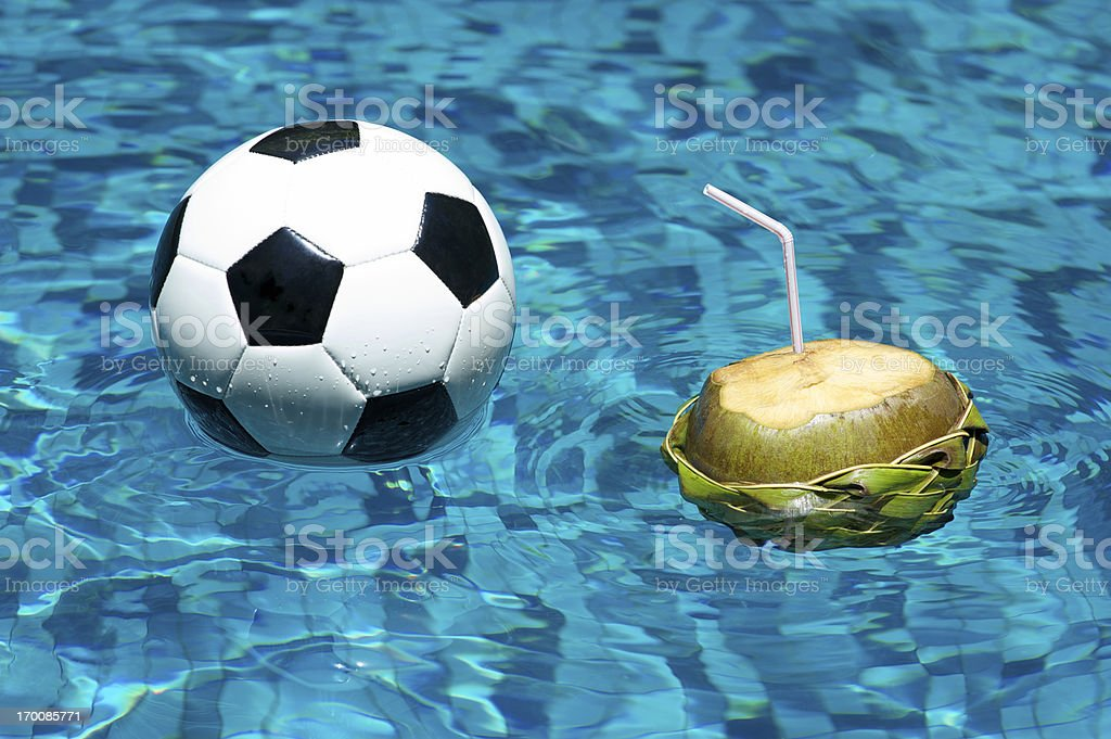 Football Soccer Ball Floating with Coconut Brazilian Pool stock photo
