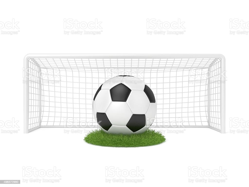Football, soccer, ball in front of goal gate on grass stock photo