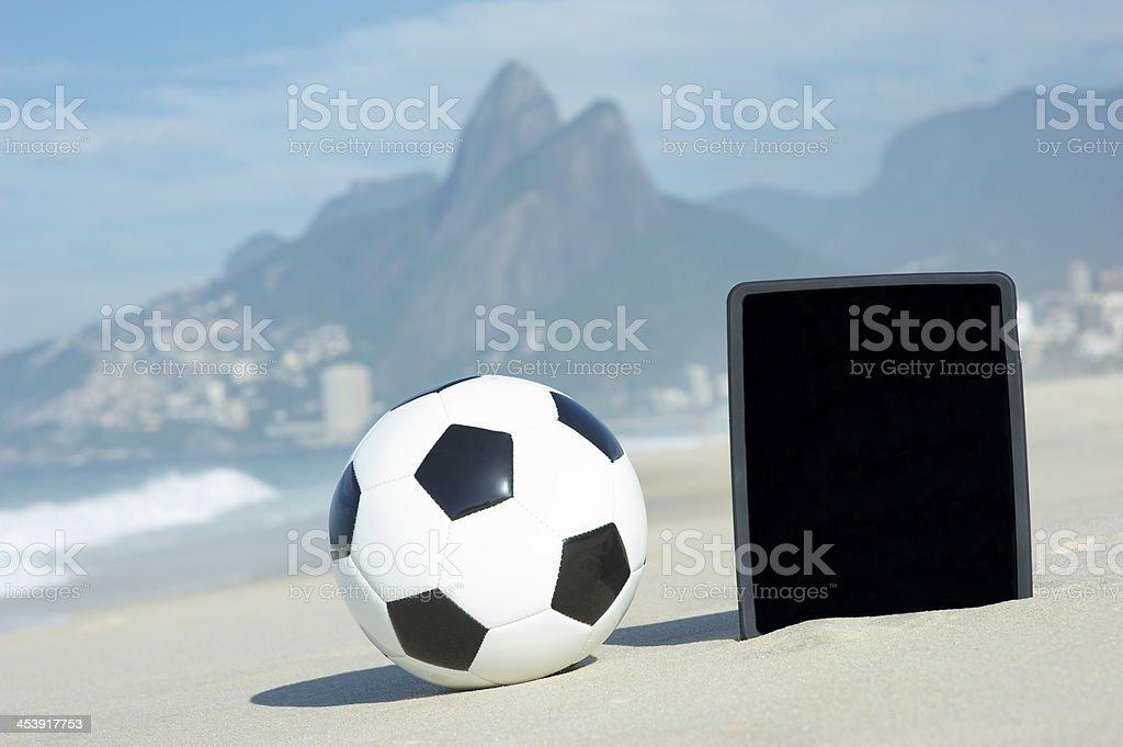 Football Soccer Ball Tablet Computer Ipanema Beach Rio de Janeiro royalty-free stock photo