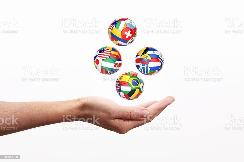 3D football, soccer ball with nations teams flags stock photo