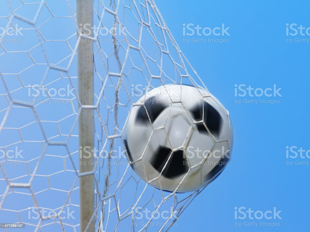Football spinning in goal against blue sky royalty-free stock photo