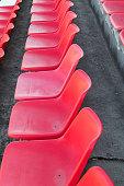 Football stadium bleachers red chairs