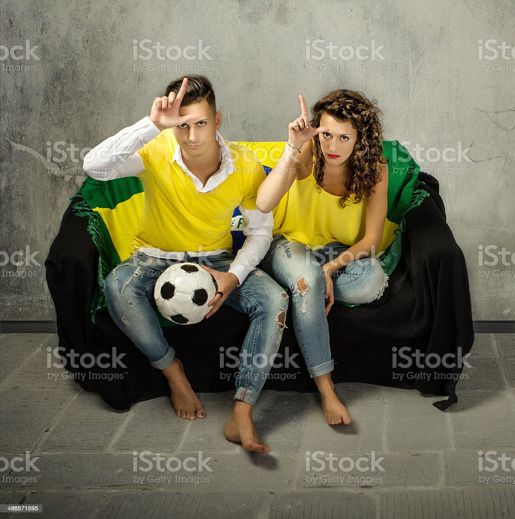 football supporter loser gesture stock photo