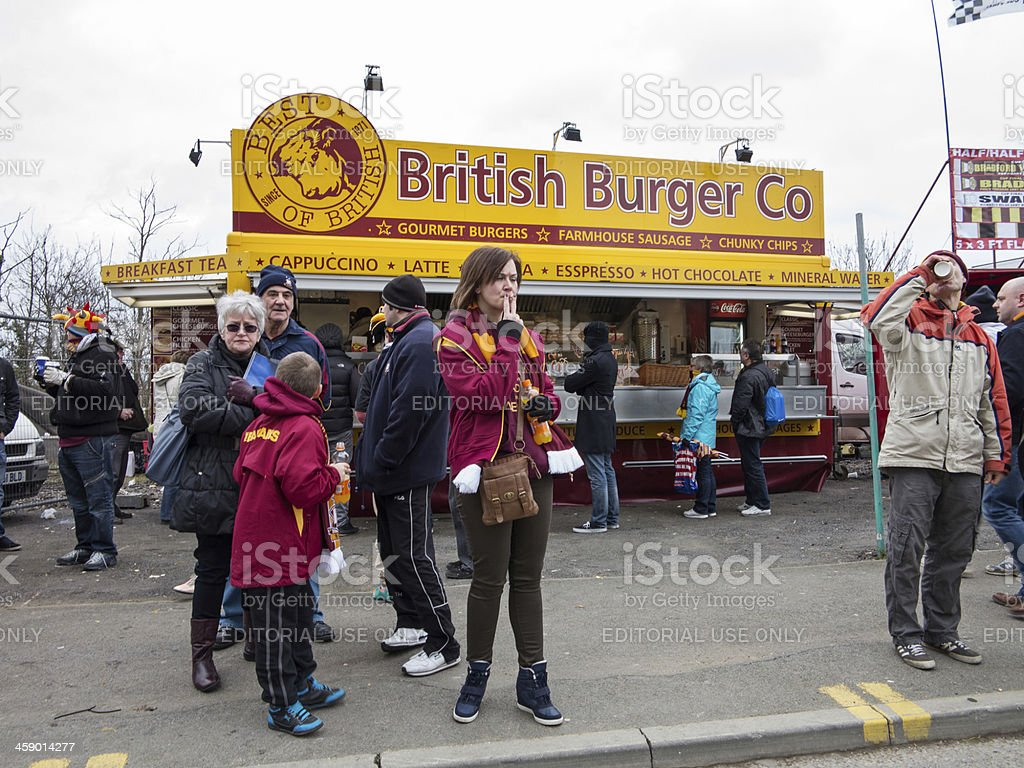 Football supporters at a roadside fast food outlet royalty-free stock photo