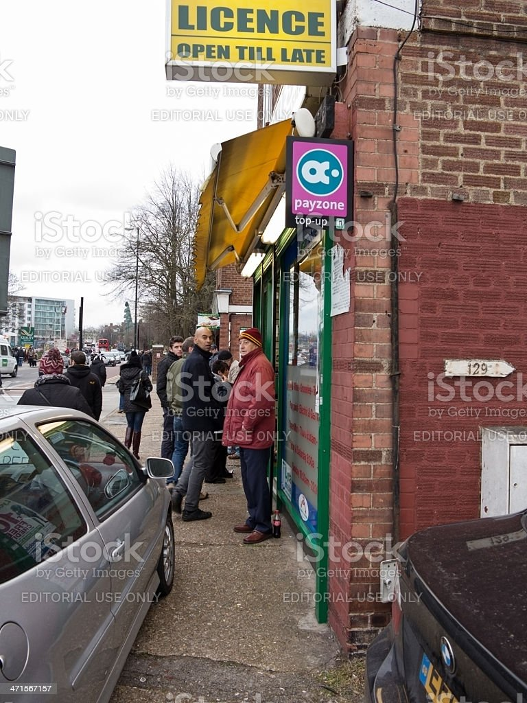 Football supporters outside off licence stock photo