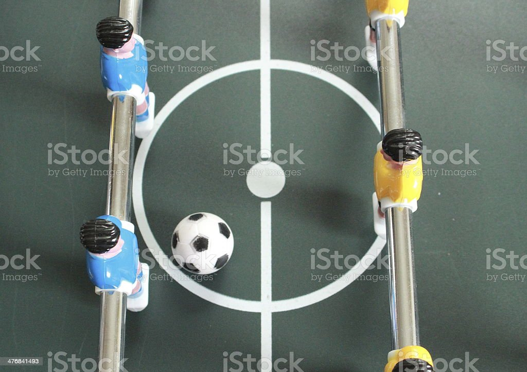 Football table game with blue and yellow players stock photo