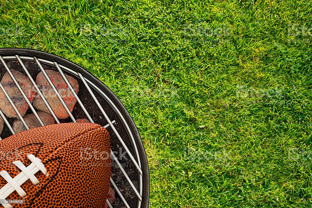 Football Tailgate BBQ Grill on Grass stock photo