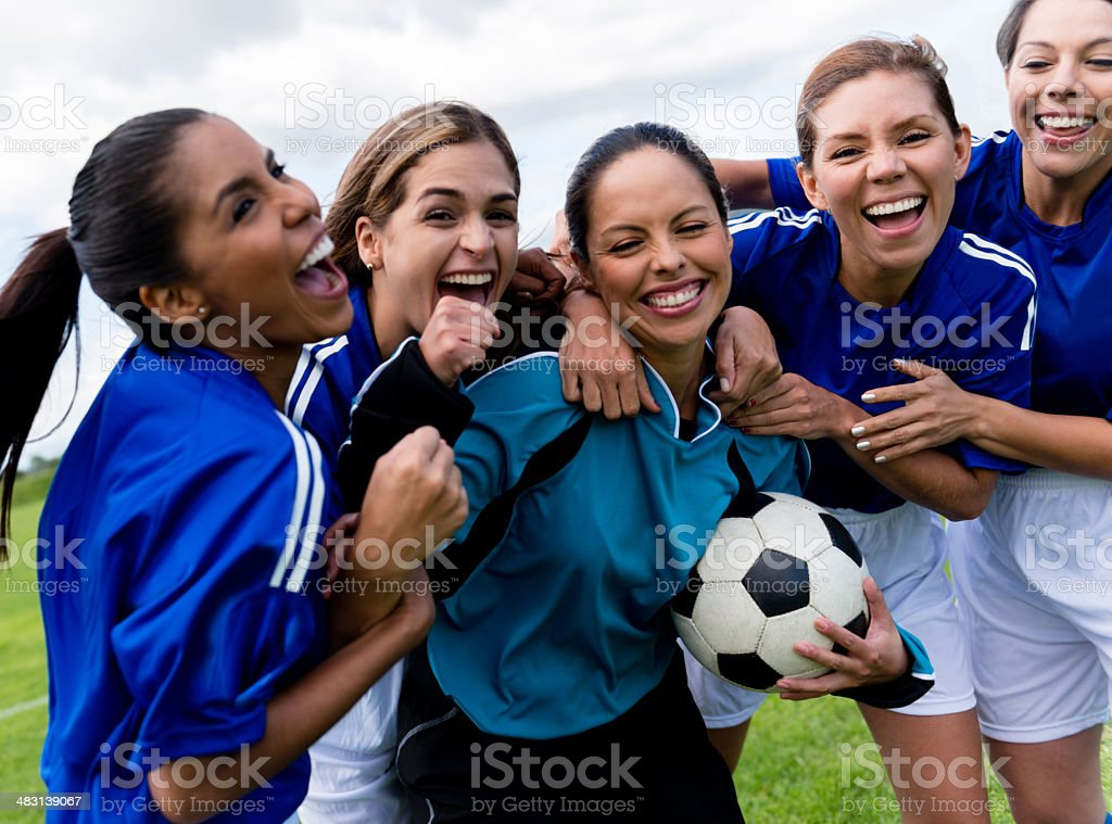 Football team celebrating a goal stock photo