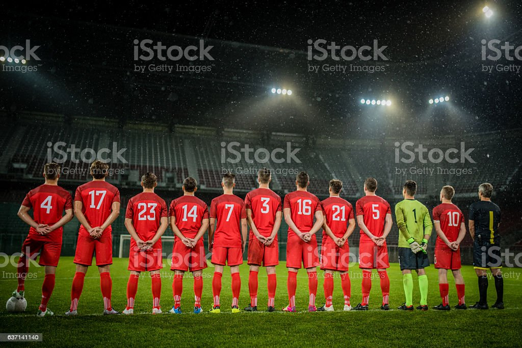 Football team in a row stock photo