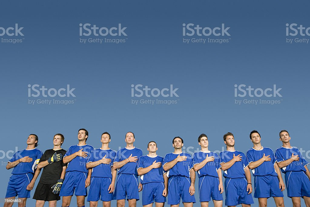 Football team in a row stock photo